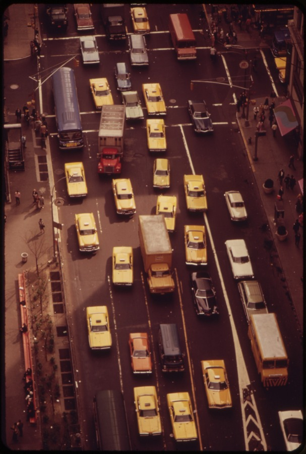 TRAFFIC IN THE HERALD SQUARE AREA OF MIDTOWN MANHATTAN NEAR INTERSECTION OF 34TH STREET AND BROADWAY. NOTE HIGH PROPORTION OF TAXICABS, 05/1973