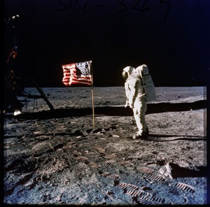Astronaut Edwin E. (Buzz) Aldrin, Jr. Posing on the Moon Next to the U.S. Flag