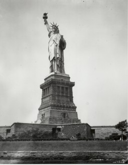 """Liberty Enlightening the World"" in 1930's New York Harbor. Photograph of the Statue of Liberty, 1930. From the Records of the Office of the Chief Signal Officer. National Archives Identifier: 594414"