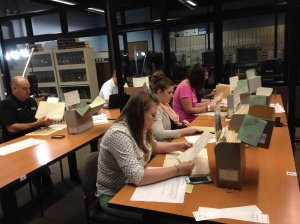 The teachers hard at work hunting for documents in the Chicago Archives.
